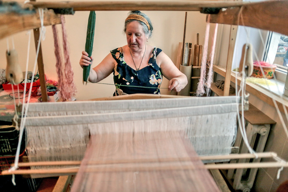 "Klavdia lives in a two room flat in a suburb of Orenburg. A large wooden loom stands in the center of the living room. ""The loom is more than 100 years old. Looms now are very expensive, but I bought this one for a song. I'm sure fate had a hand in it."""