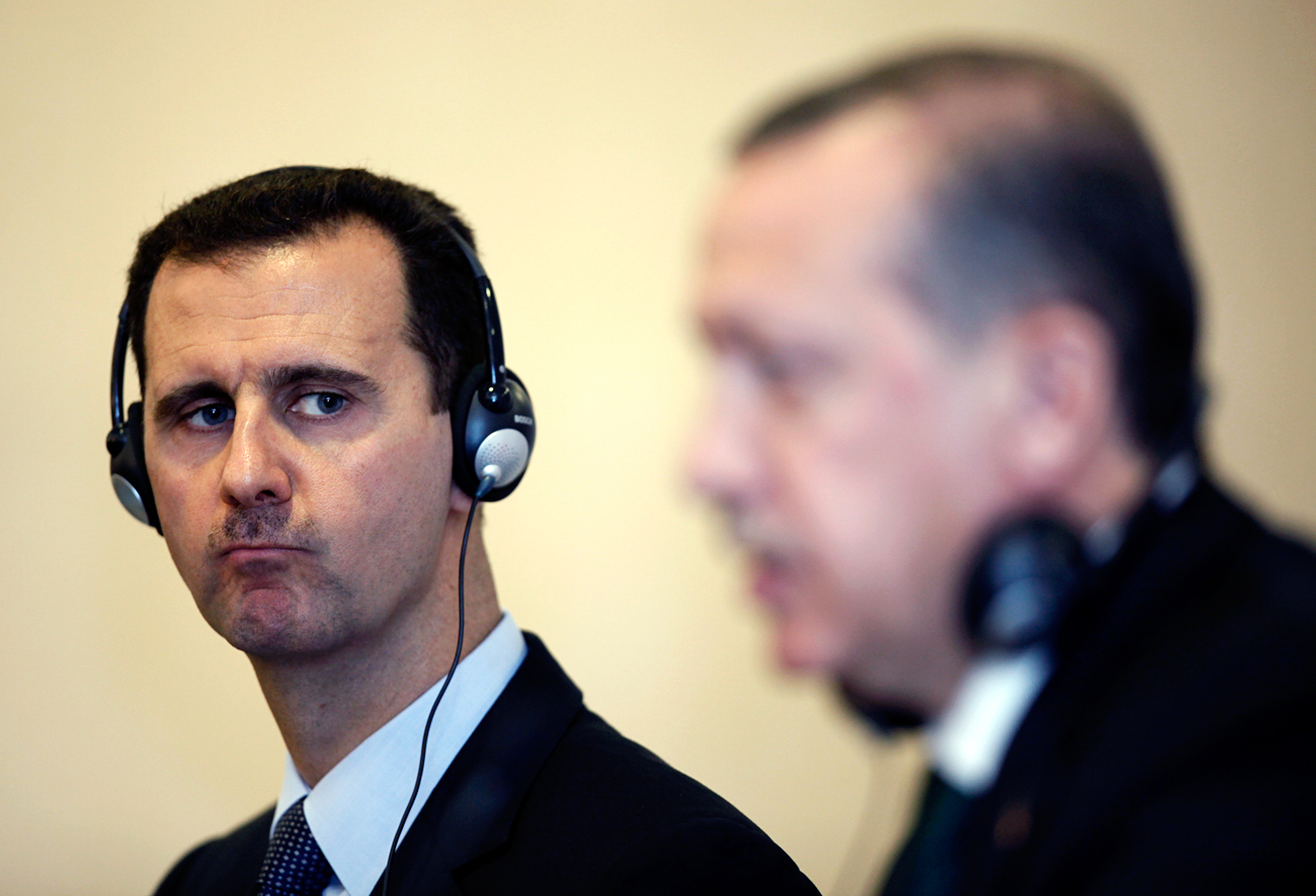 Turkey's Prime Minister Tayyip Erdogan (right) and Syria's President Bashar al-Assad attend a news conference after their meeting in Istanbul, June 7, 2010.