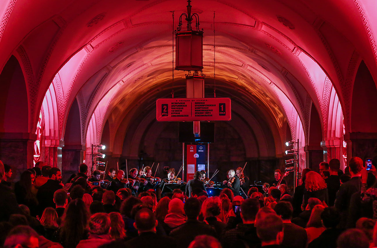 MOSCOW, RUSSIA - DECEMBER 3, 2016: Russian conductor and violinist Yuri Bashmet and his Moscow Soloists chamber orchestra performing on Friday night at the Moscow Metro's Park Kultury station on the Circle Line.