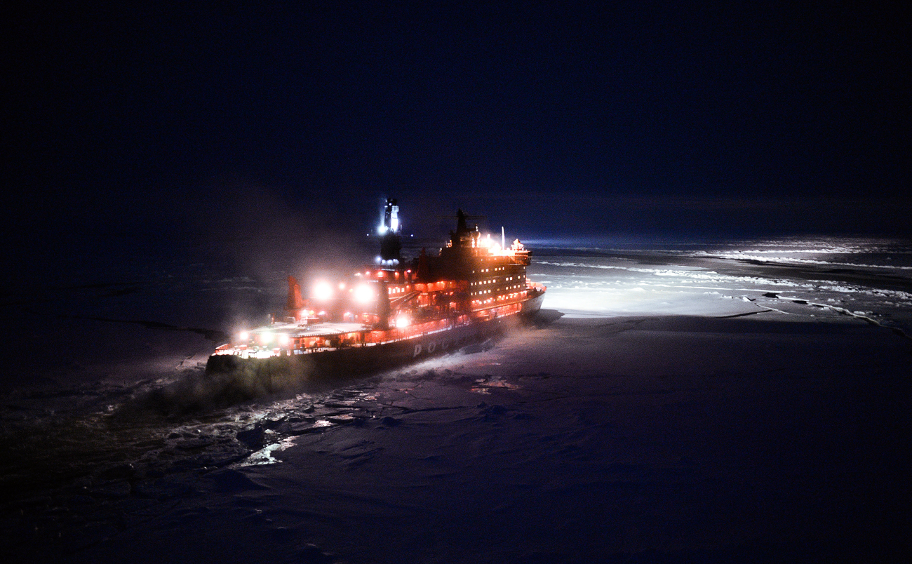"A helicopter view of the ""NS 50 Let Pobedy"" nuclear-powered icebreaker sailing toward the North Pole."