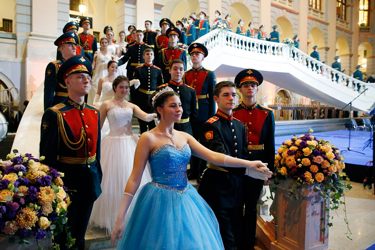 MOSCOW, RUSSIA - DECEMBER 8, 2016: Cadets in uniform and girls in evening gowns take part in the International Kremlin Cadet Ball at Moscow's Gostiny Dvor.
