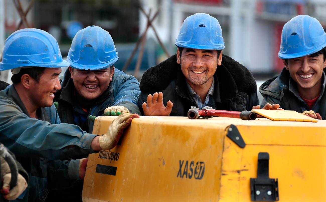 Градежни работници.