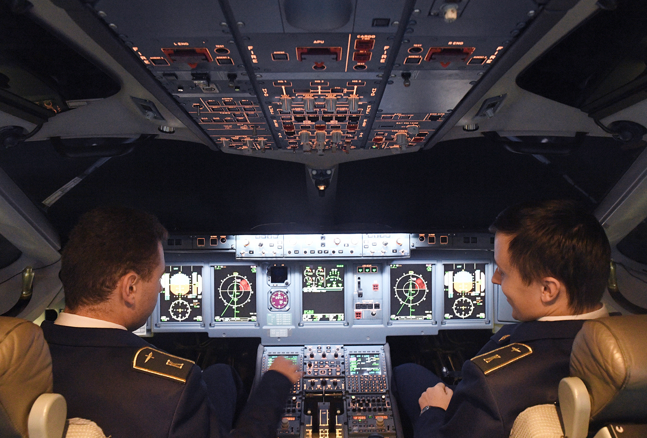 Participants in the Sukhoi Superjet 100 piloting contest 'The Best in the Sky' in the cockpit of a SSJ-100 Full Flight Simulator (FFS) in Aeroflot's Water-Land training facility at Sheremetyevo Airport