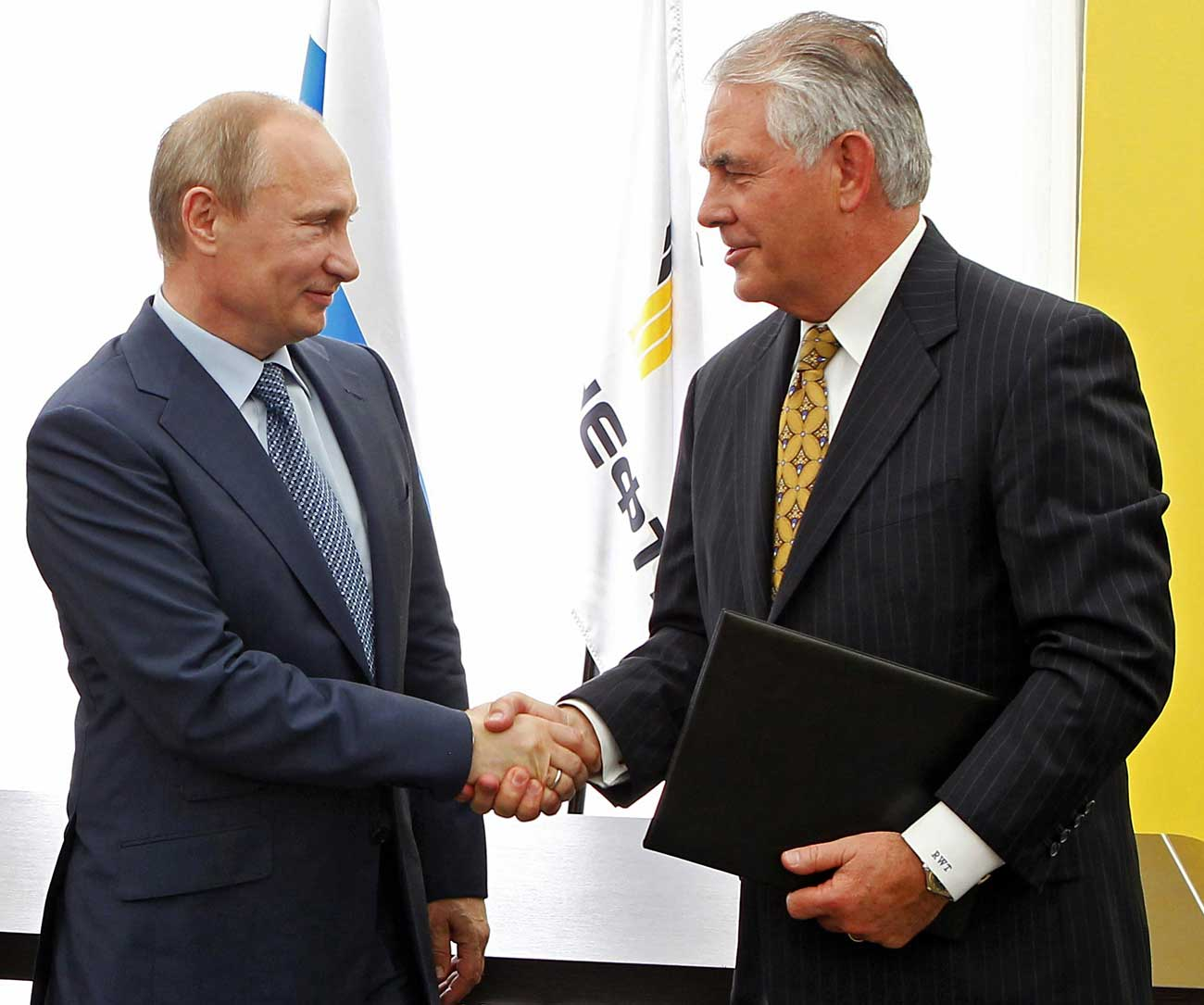 Russian President Vladimir Putin and ExxonMobil CEO Rex Tillerson shake hands at a signing ceremony of an agreement between state-controlled Russian oil company Rosneft and ExxonMobil at the Black Sea port of Tuapse, southern Russia, June 15, 2012.