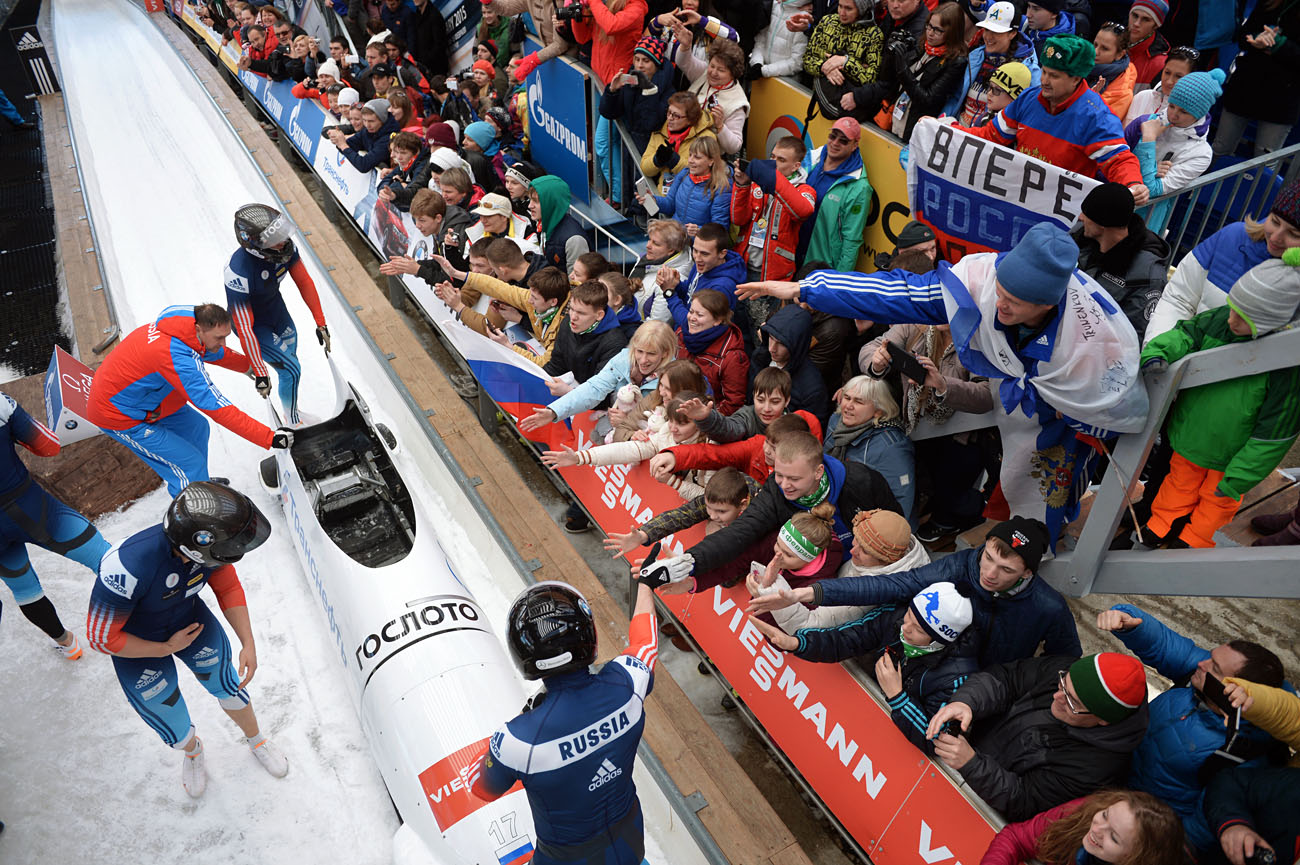Nikita Zakharov, Maxim Mokrousov, Kirill Antyukh and Vasily Kondratenko (Russia) at the finish of a heat during the four man bob event at the Bobsleigh World Cup 8 in Sochi, Feb. 15. 2015.