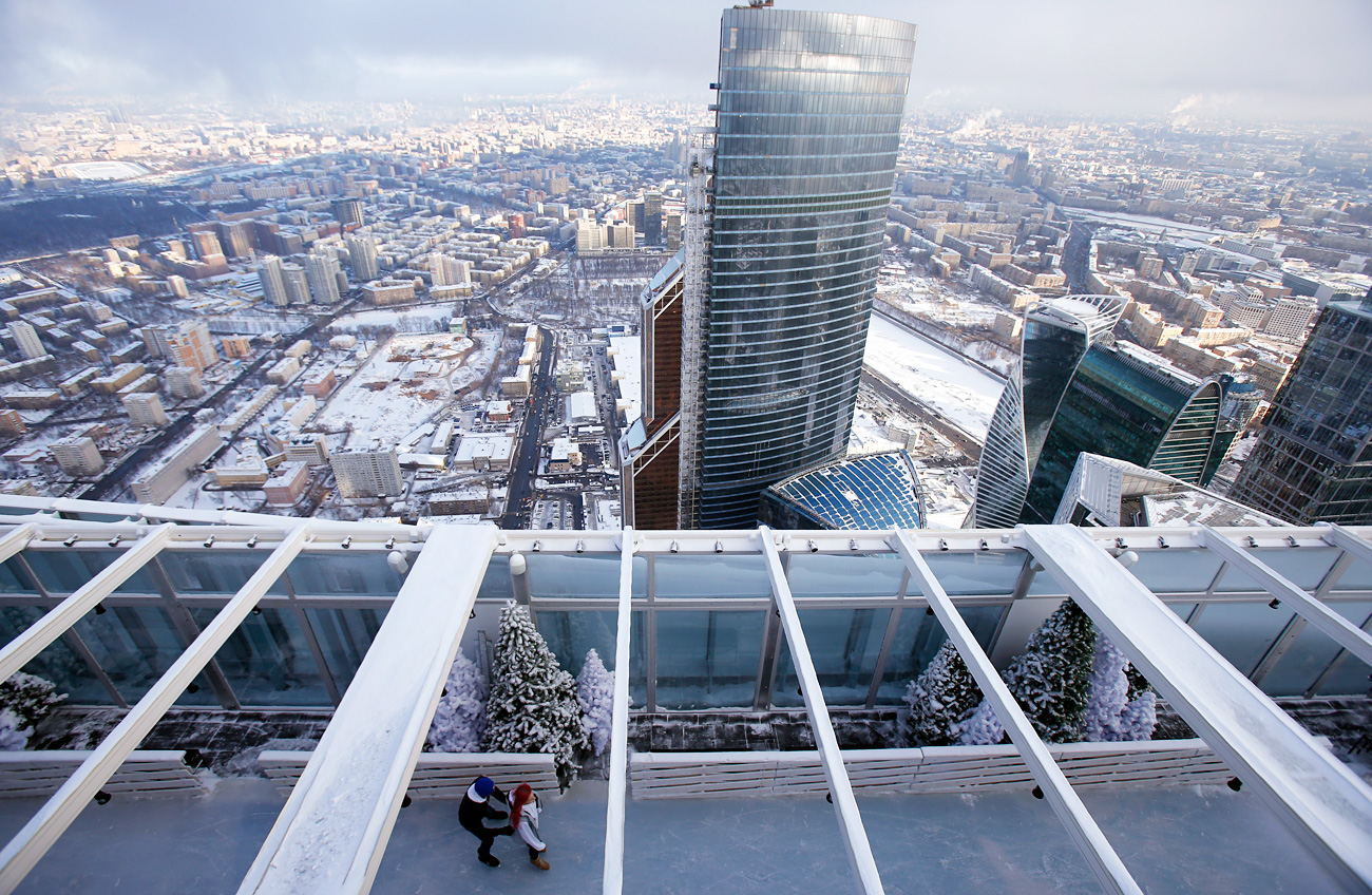 People skate during the opening of an ice rink on the roof of the skyscraper OKO, one of the towers of the Moscow International Business Centre, in Moscow, Russia, December 15, 2016.