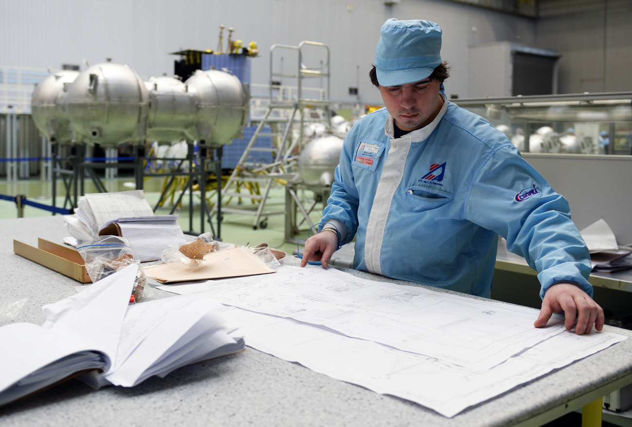 A staff member in the department of spacecraft assembly at the Lavochkin Research and Production Association, in the Moscow region.