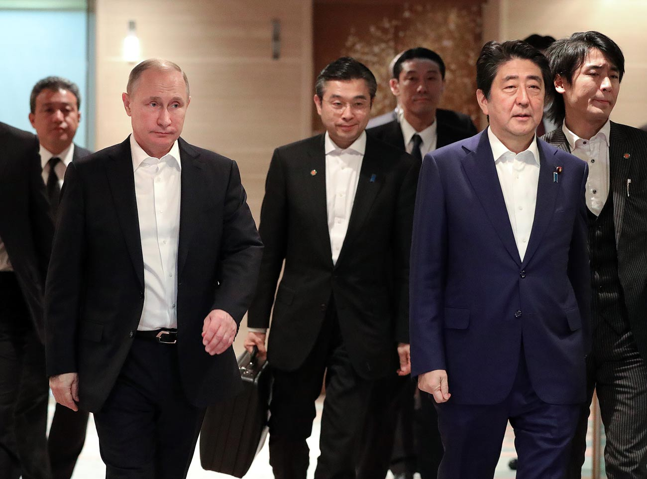 Russian President Vladimir Putin and Japanese Prime Minister Shinzo Abe, front, right, durong a meeting in Nagato, Yamaguchi Prefecture
