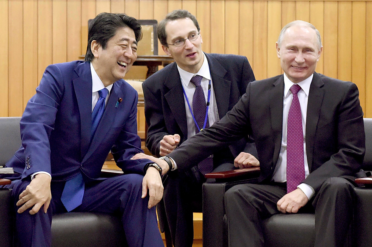 Russian President Vladimir Putin, right, chats with Japanese Prime Minister Shinzo Abe, left, during their visit to the Kodokan Judo Institute, in Tokyo, Dec. 16, 2016.