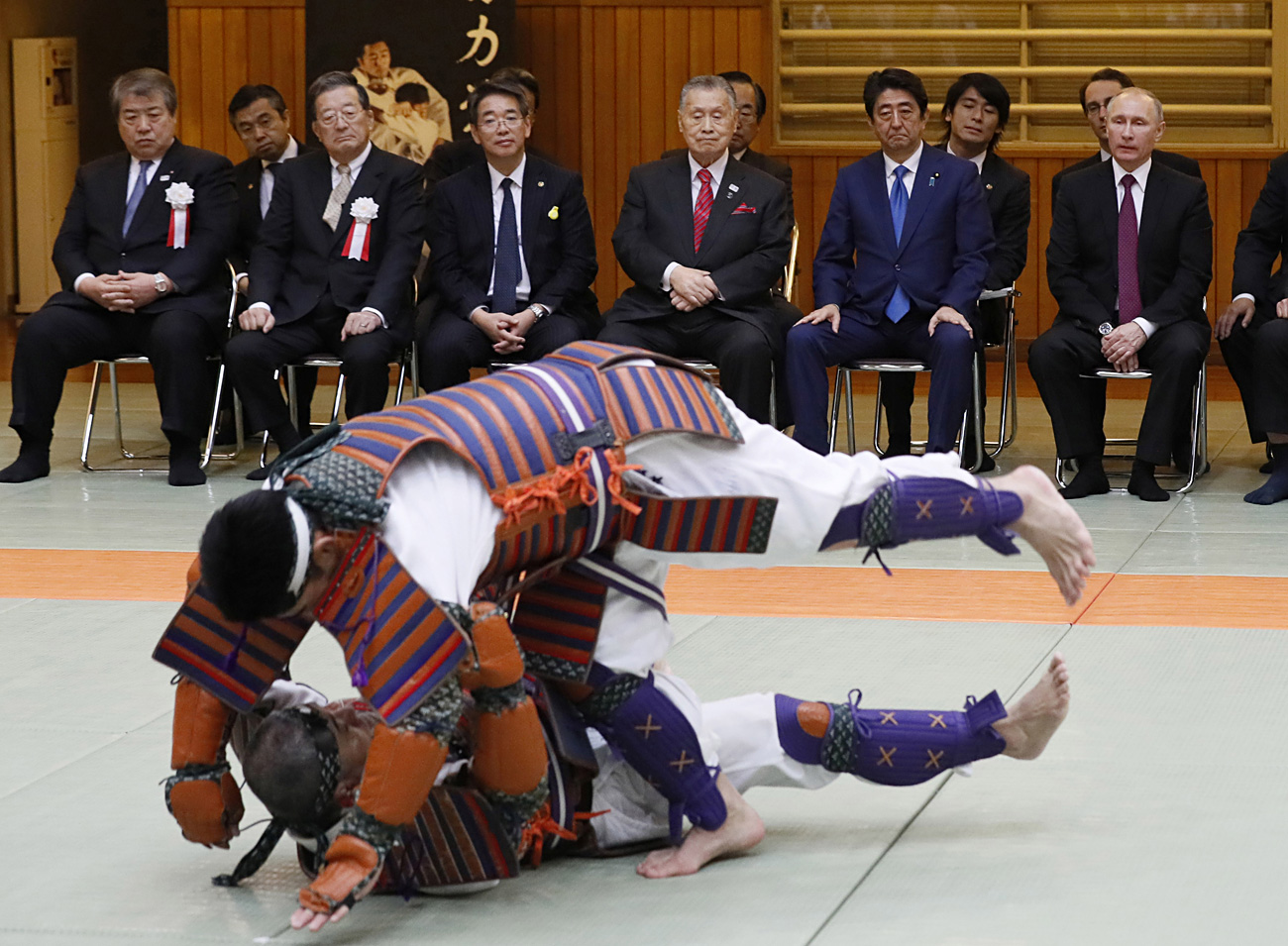 Russian President Vladimir Putin and Japanese Prime Minister Shinzo Abe watch a demonstration during their visit at Kodokan judo hall in Tokyo, Japan.