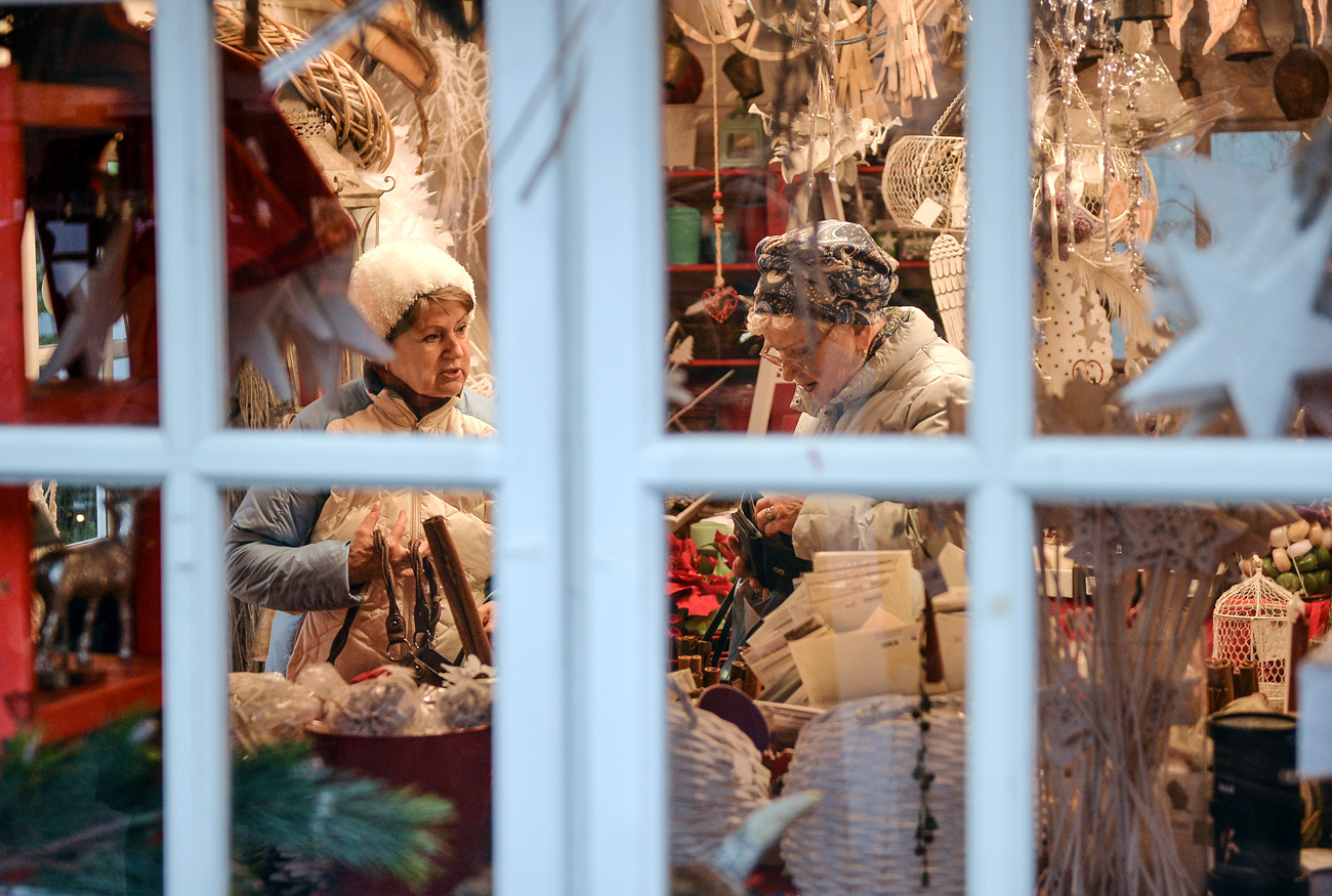 Shoppers in a souvenir stall at a Christmas fair in Moscow.
