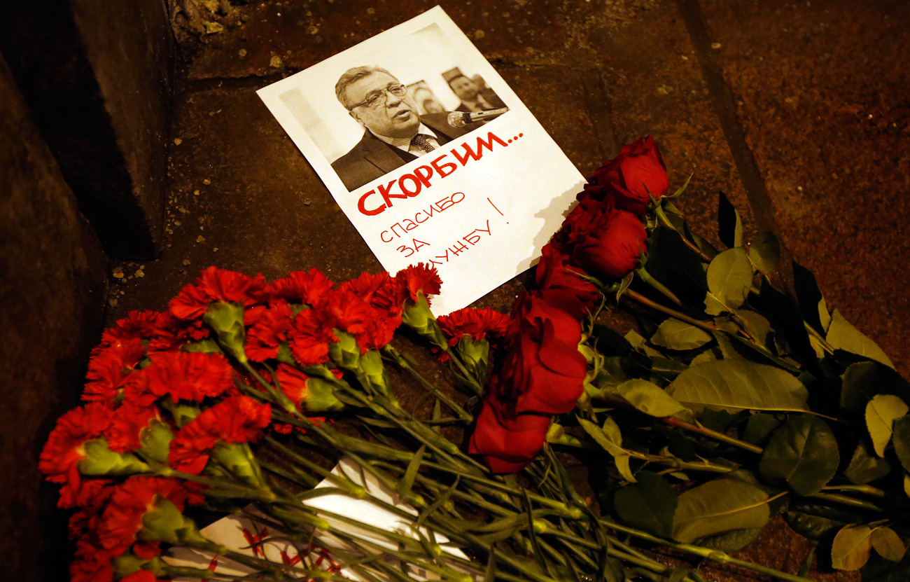 Flowers lie near a picture of Russia's Ambassador to Turkey Andrei Karlov outside the Russian foreign ministry in Moscow, Dec. 19, 2016. Andrey Karlov has been shot at an art exhibition in the Turkish capital of Ankara.
