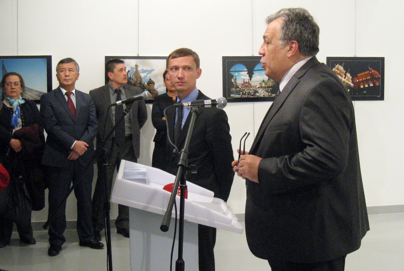 Russia's ambassador to Turkey, Andrey Karlov (R) speaks just before he was shot by a gunman at the art exhibition in Ankara, Turkey, on Dec. 19. Russia's ambassador to Turkey, Andrey Karlov, has been shot at an art exhibition in the Turkish capital of Ankara.