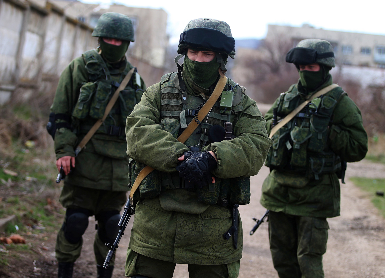 Masked servicemen stand near the territory of the 36th separate brigade of the Ukrainian Navy coastal defence at the naval base in Perevalnoe, Crimea in March 2014.