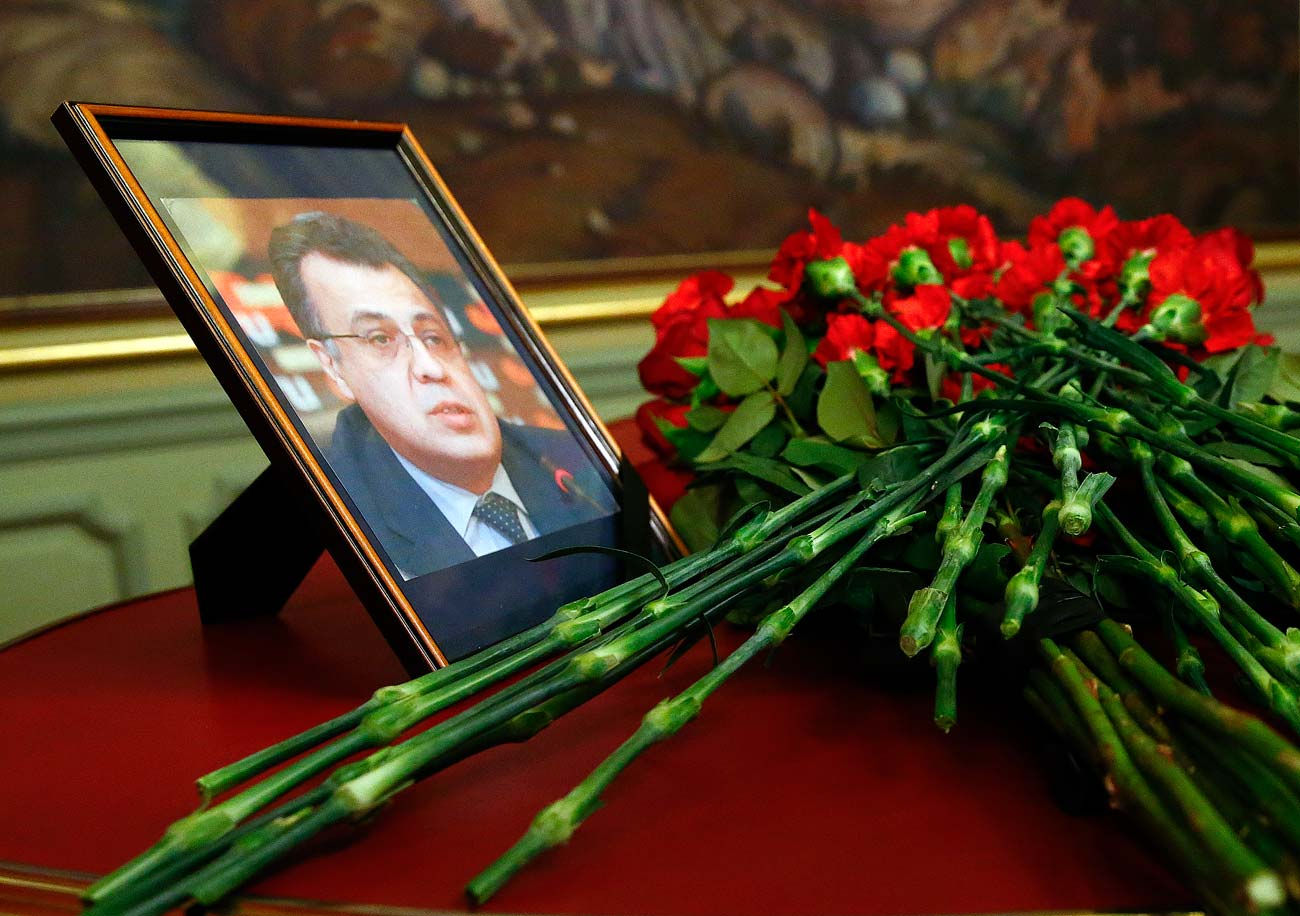 Flowers are placed near a portrait of murdered Russian ambassador to Turkey Andrei Karlov during a meeting of Russian Foreign Minister Sergei Lavrov with his Turkish counterpart Mevlut Cavusoglu in Moscow, Russia