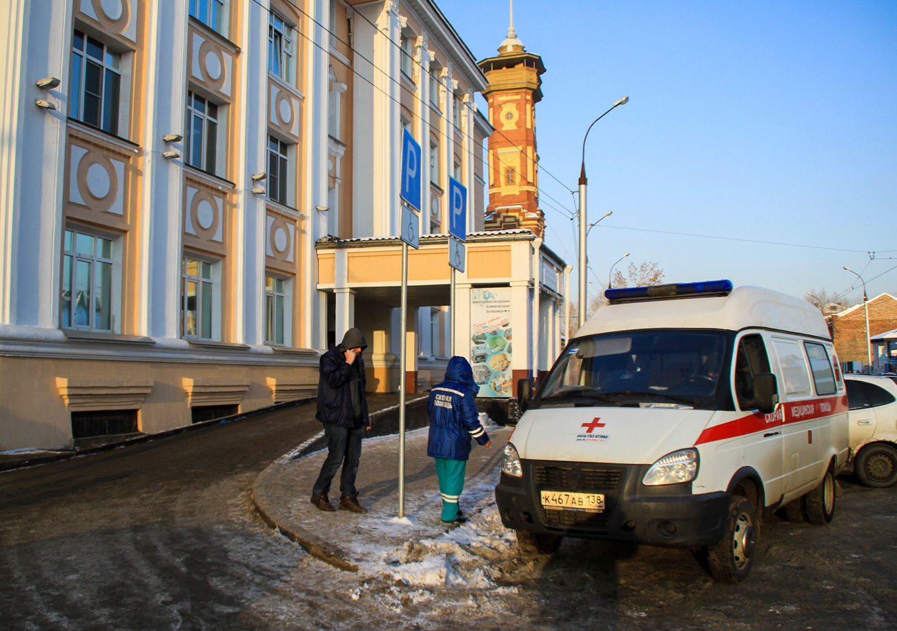 An ambulance outside Clinical Hospital No.3 in the city of Irkutsk, where 71 people have died of poisoning with alcohol-containing liquids.