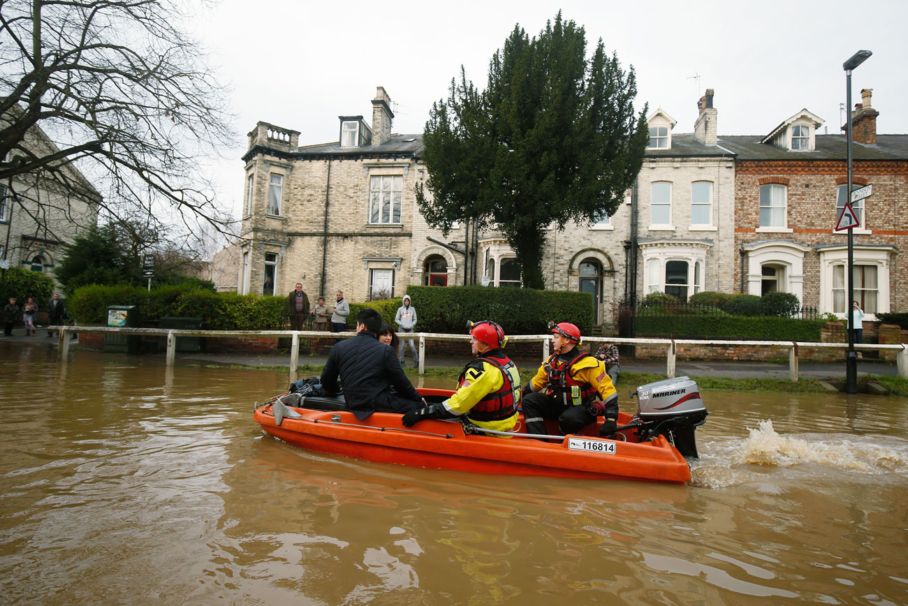 Turning the tide: urgent action on climate change is necessary to help prevent global flooding events, such as this one in the UK last December.