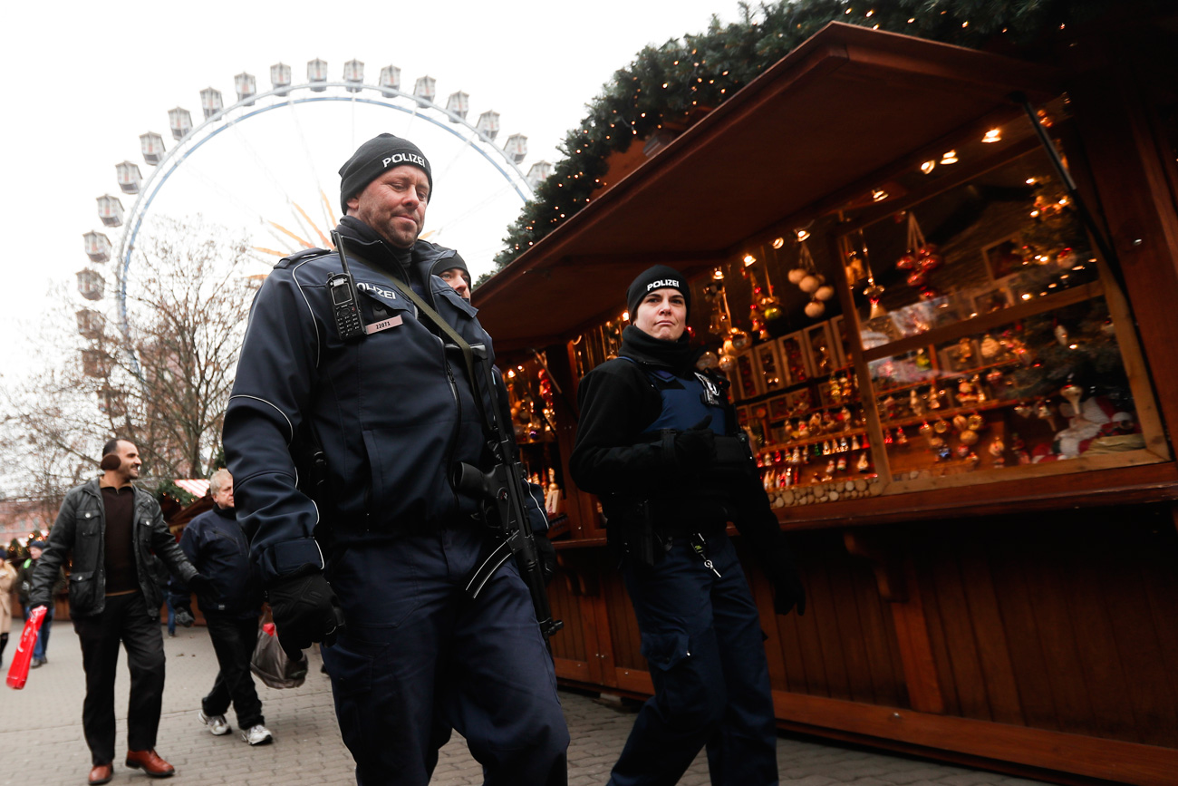 Police officers patrol over a Christmas market near the city hall in Berlin on Dec. 21, 2016, two days after a truck ran into the crowded Christmas market at the Breitscheidplatz in the city and killed several people.