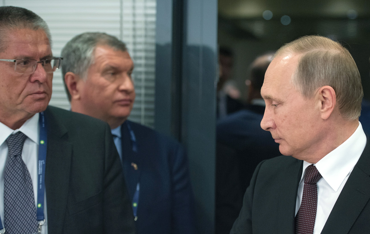 October 10, 2016. From right: Russian President Vladimir Putin, Rosneft Chief Executive Officer Igor Sechin and Economic Development Minister Alexei Ulyukayev