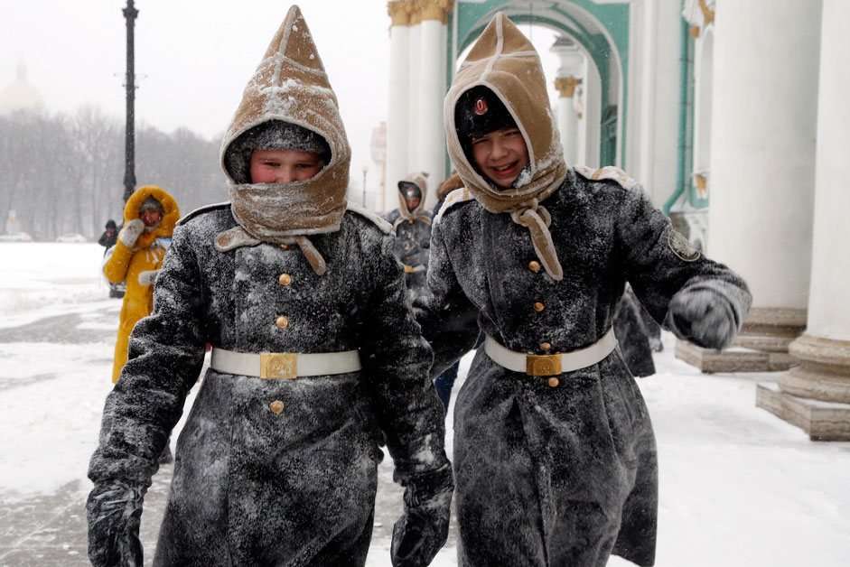 Pupils of Navy cadet classes walk in snow in St.Petersburg, Russia, Tuesday, Jan. 12, 2016. Low temperatures caused the two-days of snowfall in St.Petersburg.