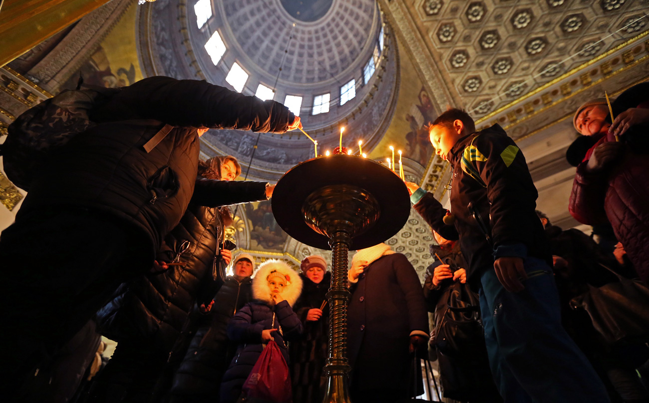 ST PETERSBURG, RUSSIA - JANUARY 6, 2017: Believers at the Kazan Cathedral on Christmas Eve. The Russian Orthodox Church celebrates Christmas according to the Julian calendar.