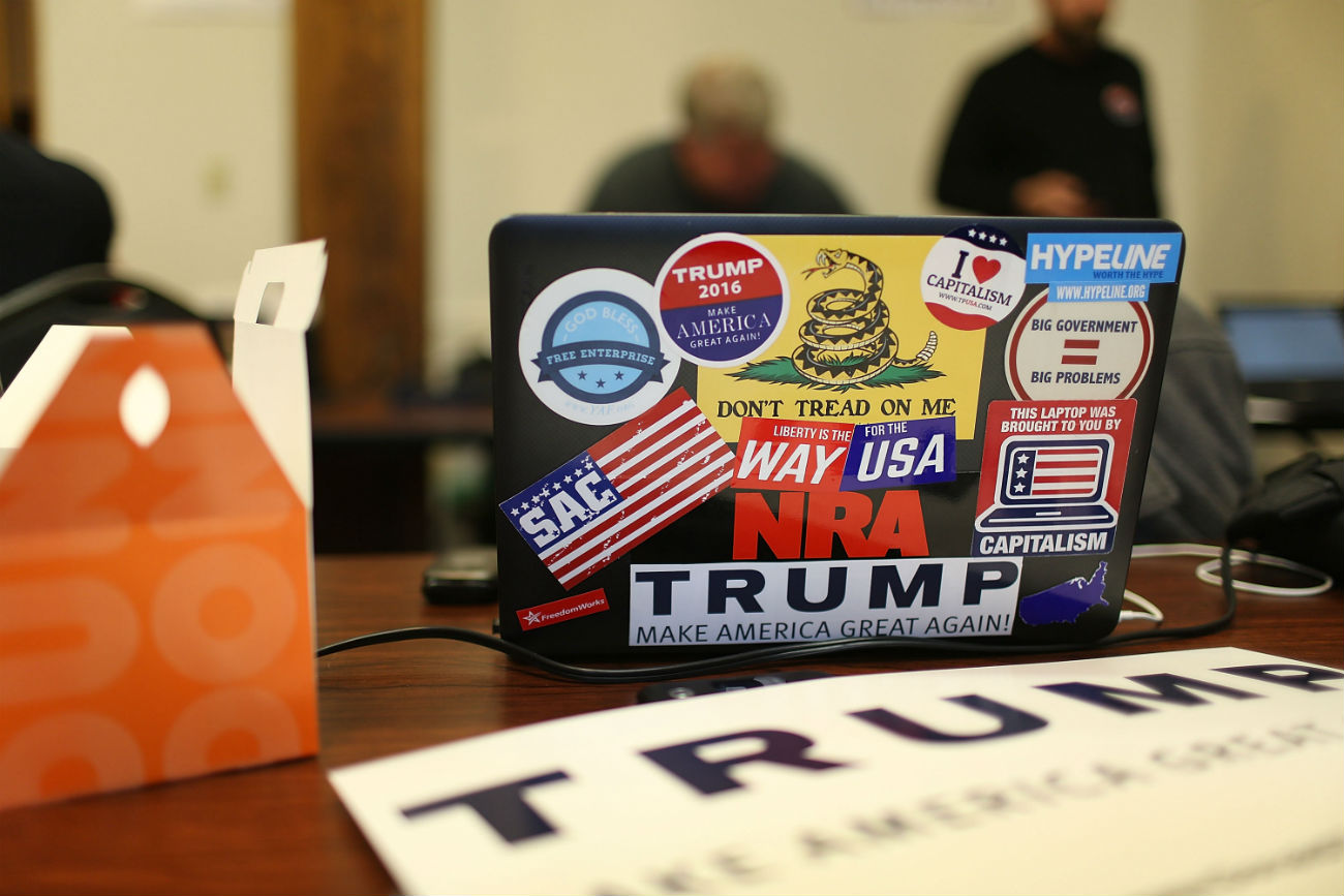 A computer is covered with stickers as volunteers call people asking them to vote for Republican presidential canddiate Donald Trump.