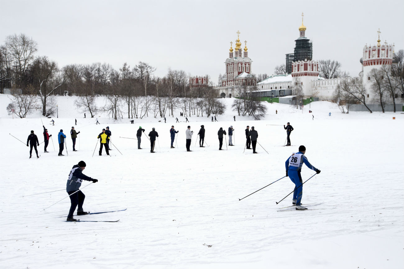 Skiers race on a frozen pond near Moscow's Novodevichy convent as temperaturesrose after a cold spell in Moscow, Tuesday, Jan. 10, 2017. That day the capital warmed up - to minus 9 Celsius (-15.8 Fahrenheit)