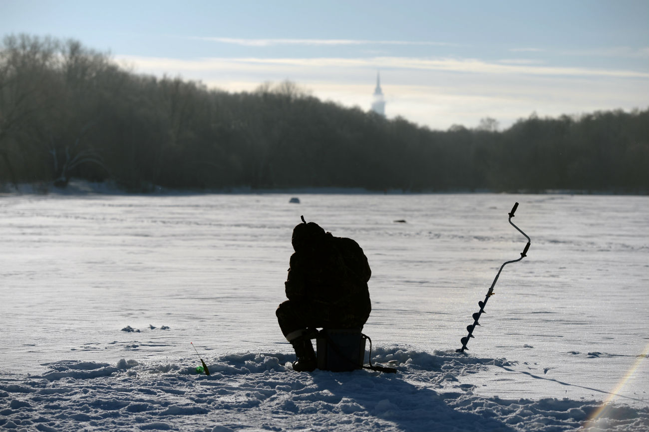 A man ice fishing at Bolshoi Sadovy Pond, Timiryazev Agricultural Academy Park, Moscow, Jan. 8, 2107