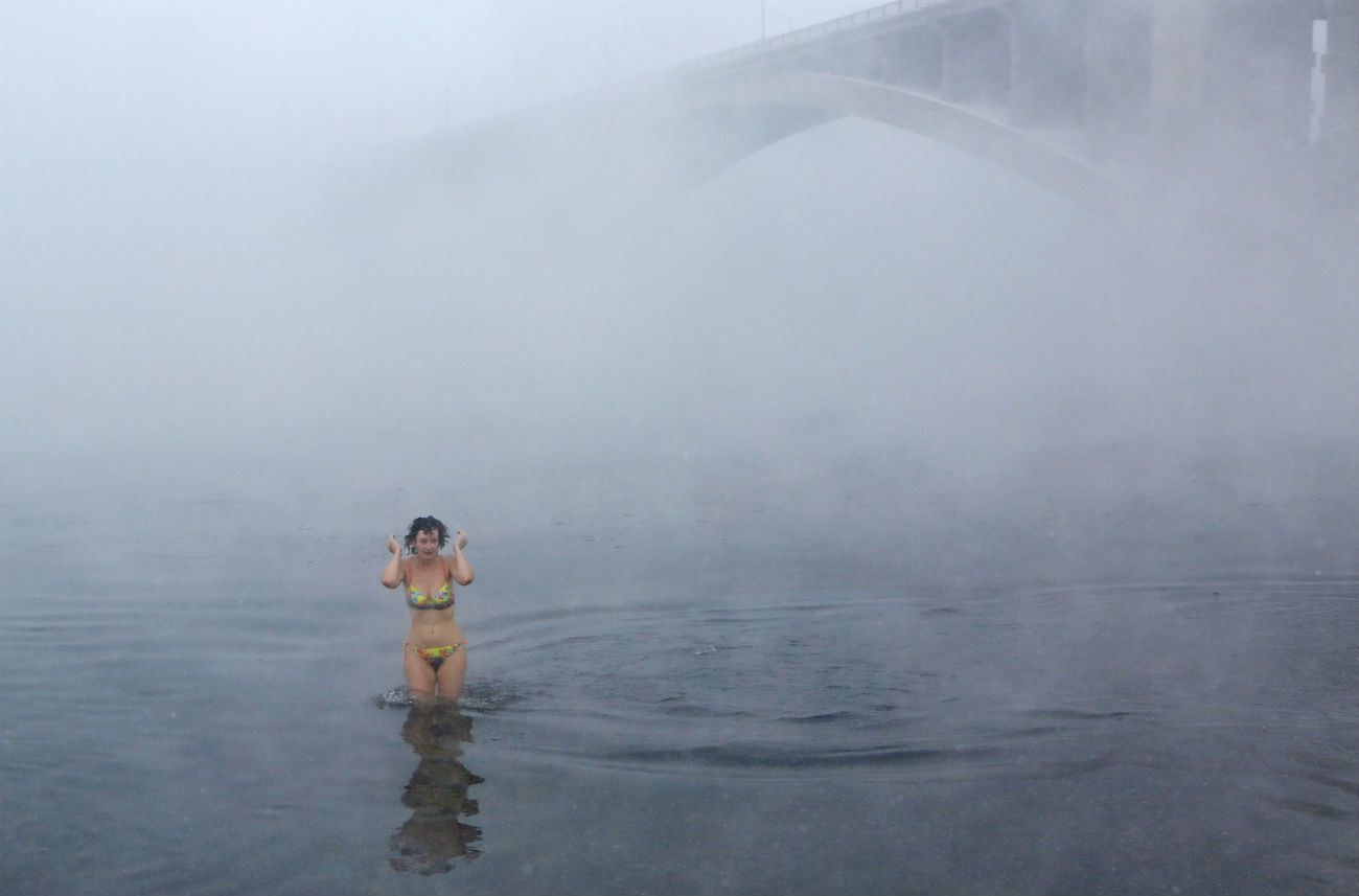 A member of the Cryophile amateur winter swimming club takes a bath in the icy waters of the Yenisei River during celebrations for the upcoming Christmas and New Year, with the air temperature at about minus 34 degrees Celsius (-29.2 Fahrenheit), in Krasnoyarsk, Dec. 24, 2016