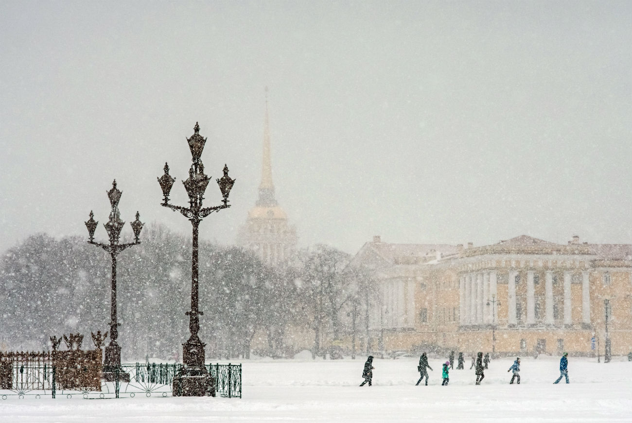 Snowfall on Palace Square in St. Petersburg.