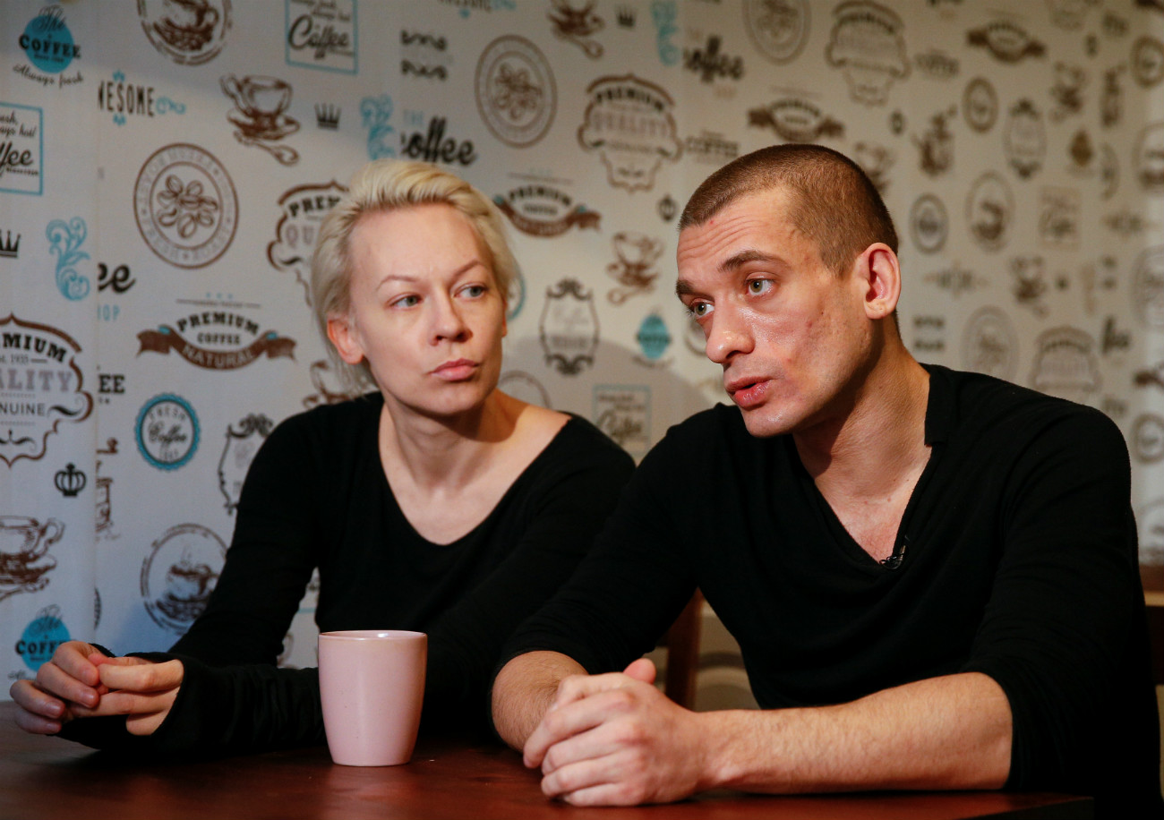 Russian artist Pyotr Pavlensky (R) speaks while his partner Oksana Shalygina looks on during an interview with Reuters in Kiev, Ukraine.