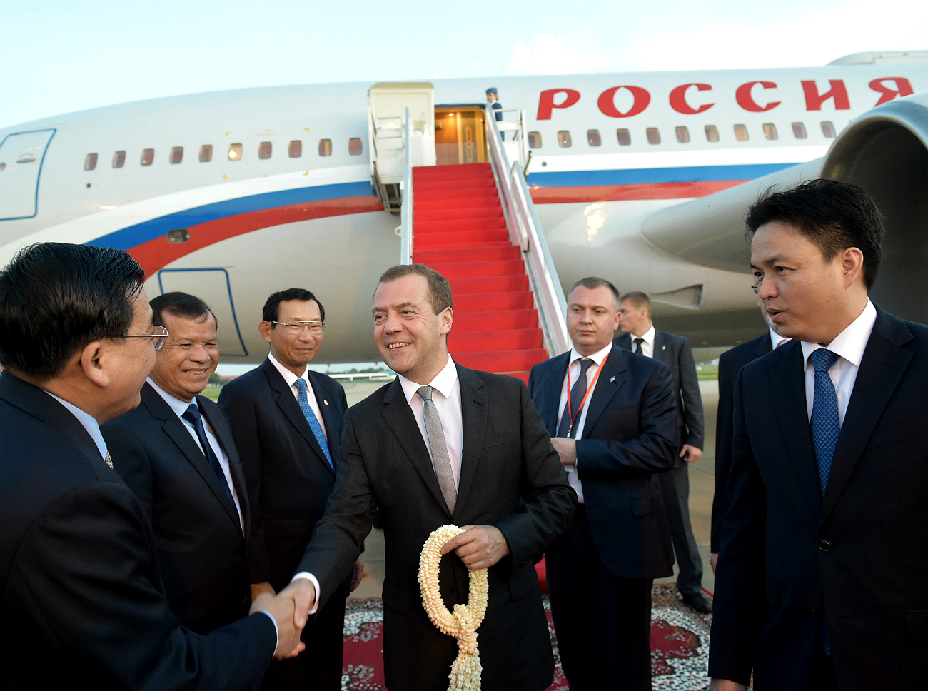 November 23, 2015. Russian Prime Minister Dmitry Medvedev, center, is welcomed at Phnom Penh International Airport during his working visit to the Kingdom of Cambodia.