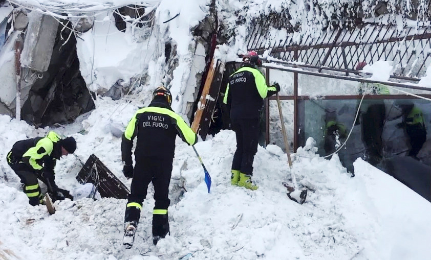 Firefighters work at Hotel Rigopiano in Farindola, central Italy, after it was hit by an avalanche, in this handout picture released on January 20, 2017 provided by Italy's Fire Fighters.