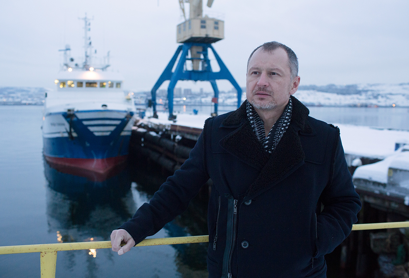 Vitaly Orlov, billionaire and chief executive officer of Norebo Holding JSC, poses for a photograph while standing on the quayside near the Yakov Gunin, a stern fishing trawler in Murmansk, Russia, Jan. 13, 2017.