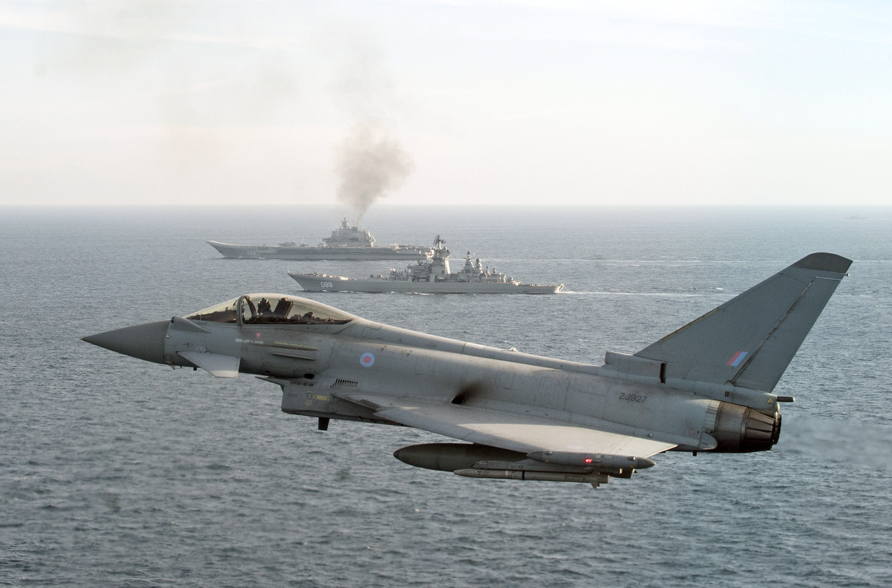A RAF Typhoon escorts the Russian warships Pyotr Veliky and Admiral Kuznetsov.