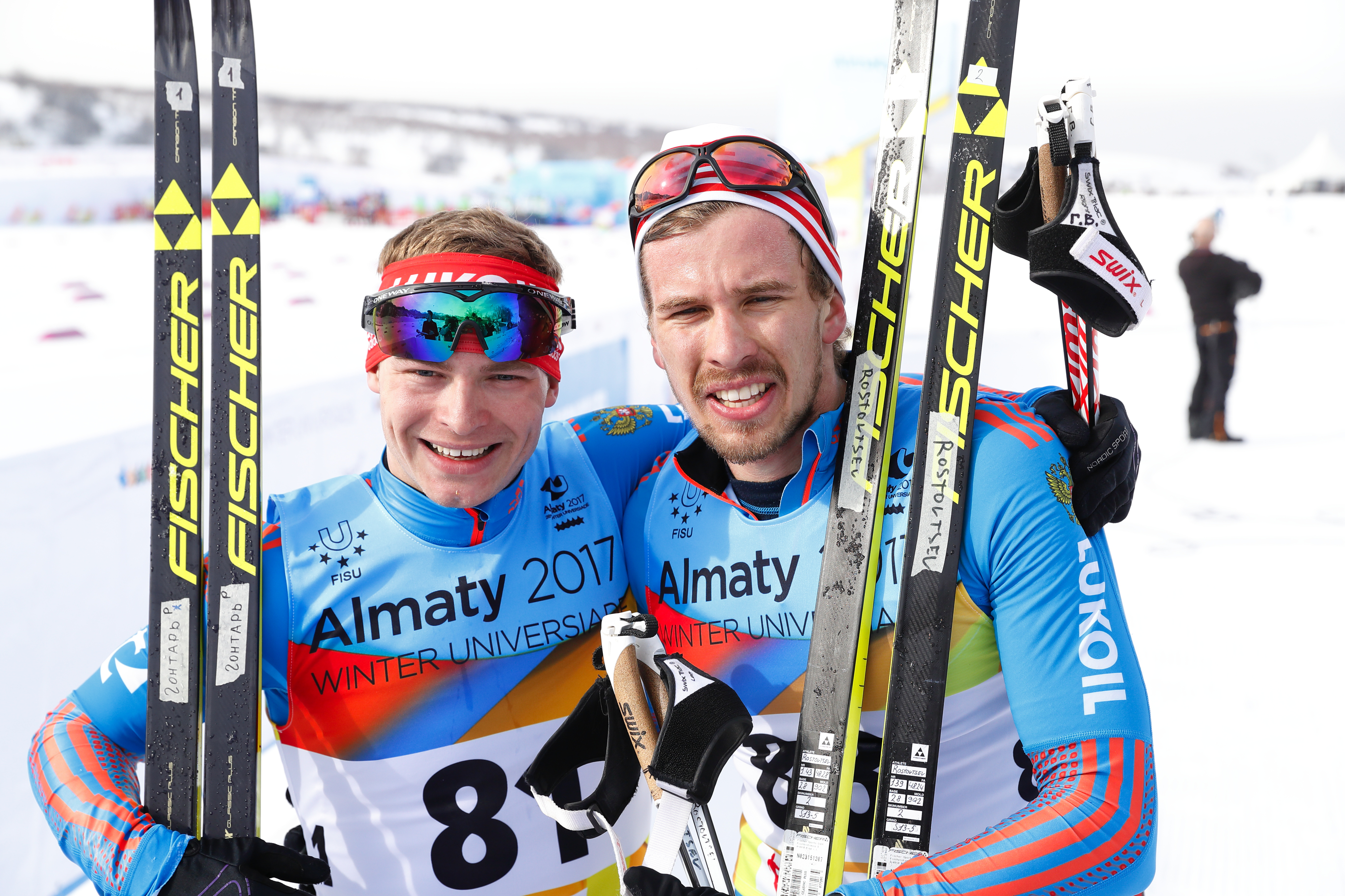 Skier Valery Gontar (left) wins gold medal at the  2017 Winter Universiade in Almaty.