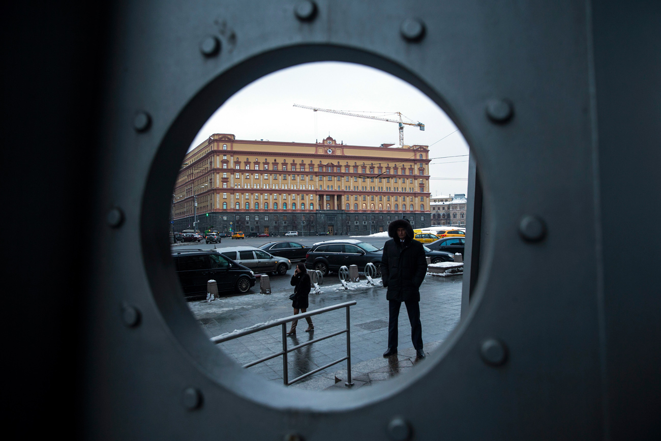 A security man stands in Lubyanka Square, with the main building of the Russian Federal Security Service, former KGB headquarters, in the background.