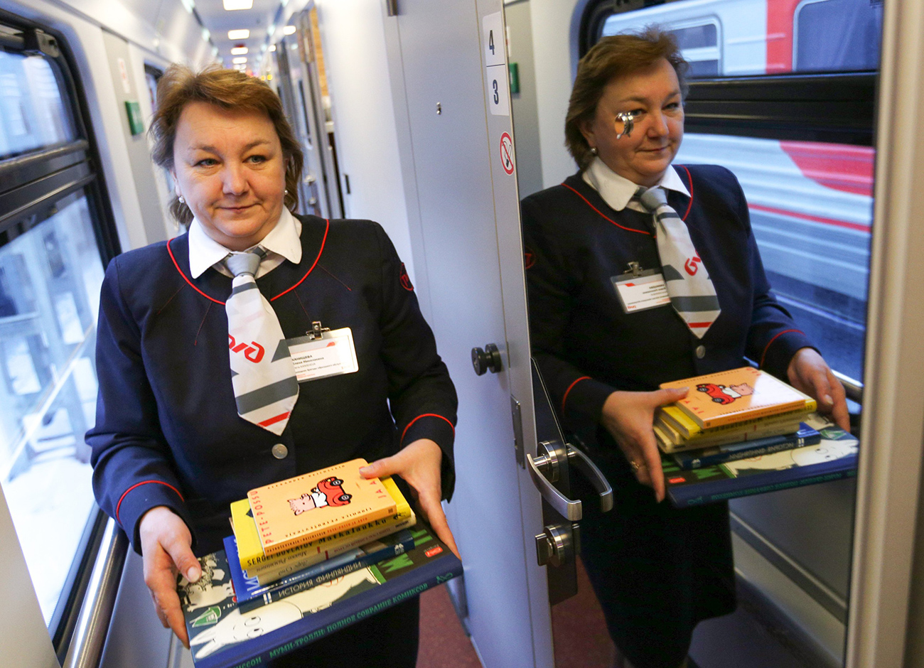Ask the train staff for a book. Source: Kirill Zykov / Moskva Agency