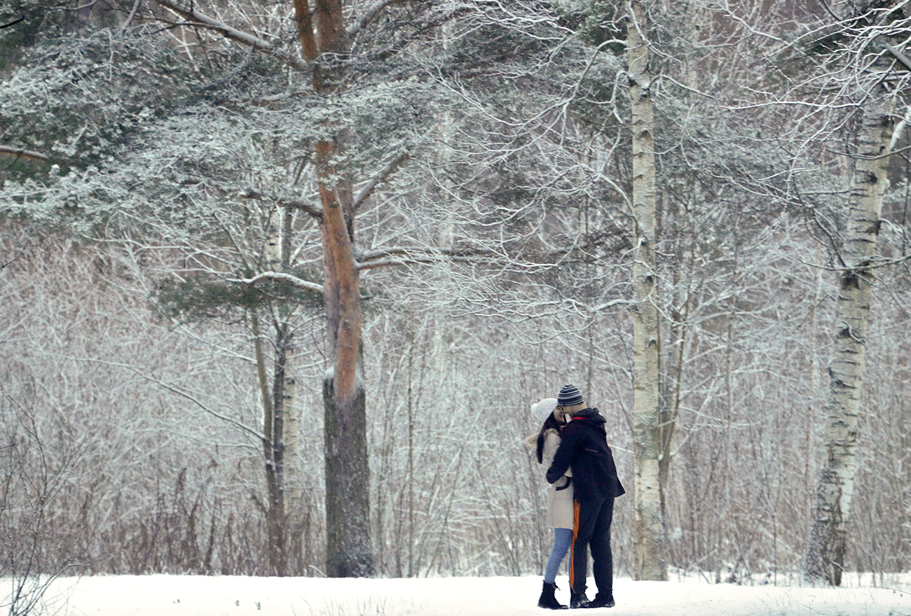 A tender moment in a snowbound park in St. Petersburg.