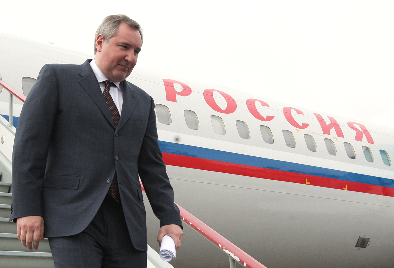 Deputy Prime Minister and special envoy of the Russian President Dmitry Rogozin comes down the stairs from his plane at the airport in Kishinev where he arrived on a working visit.