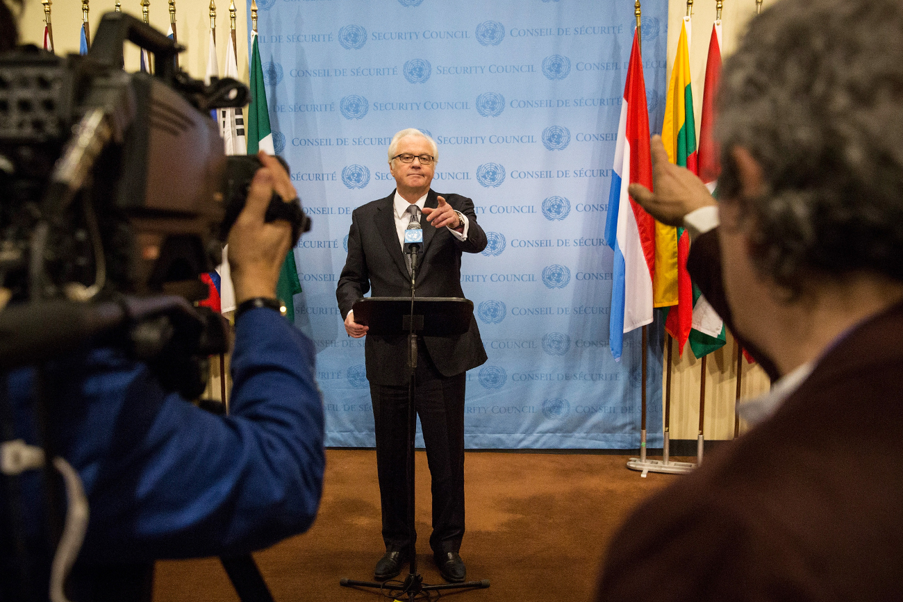 Russian Permanent Representative to the United Nations (UN) Vitaly Churkin speaks to members of the media after a UN Security Council meeting