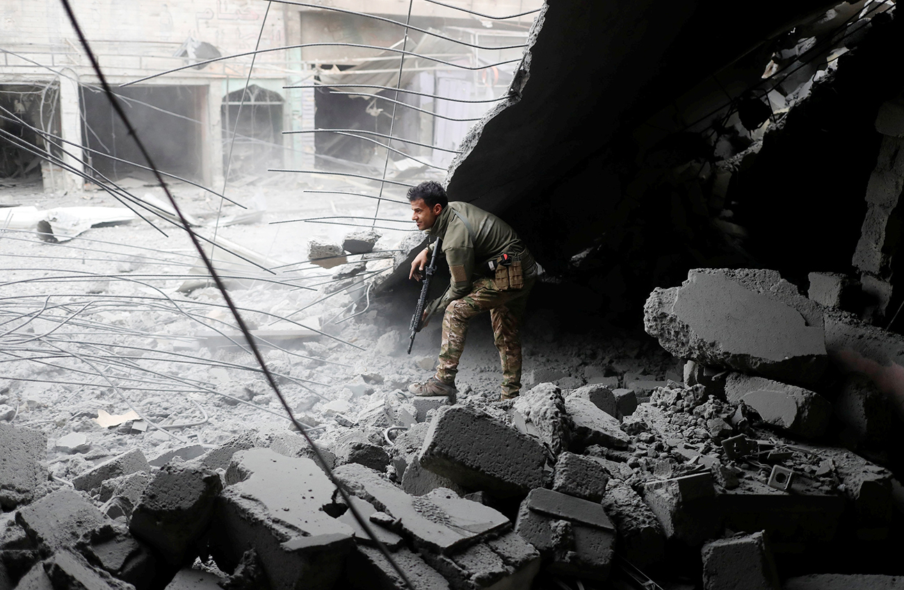 An Iraqi special forces soldiers walks through a house destroyed in an airstrike during a battle with Islamic State militants in Mosul, March 2, 2017.