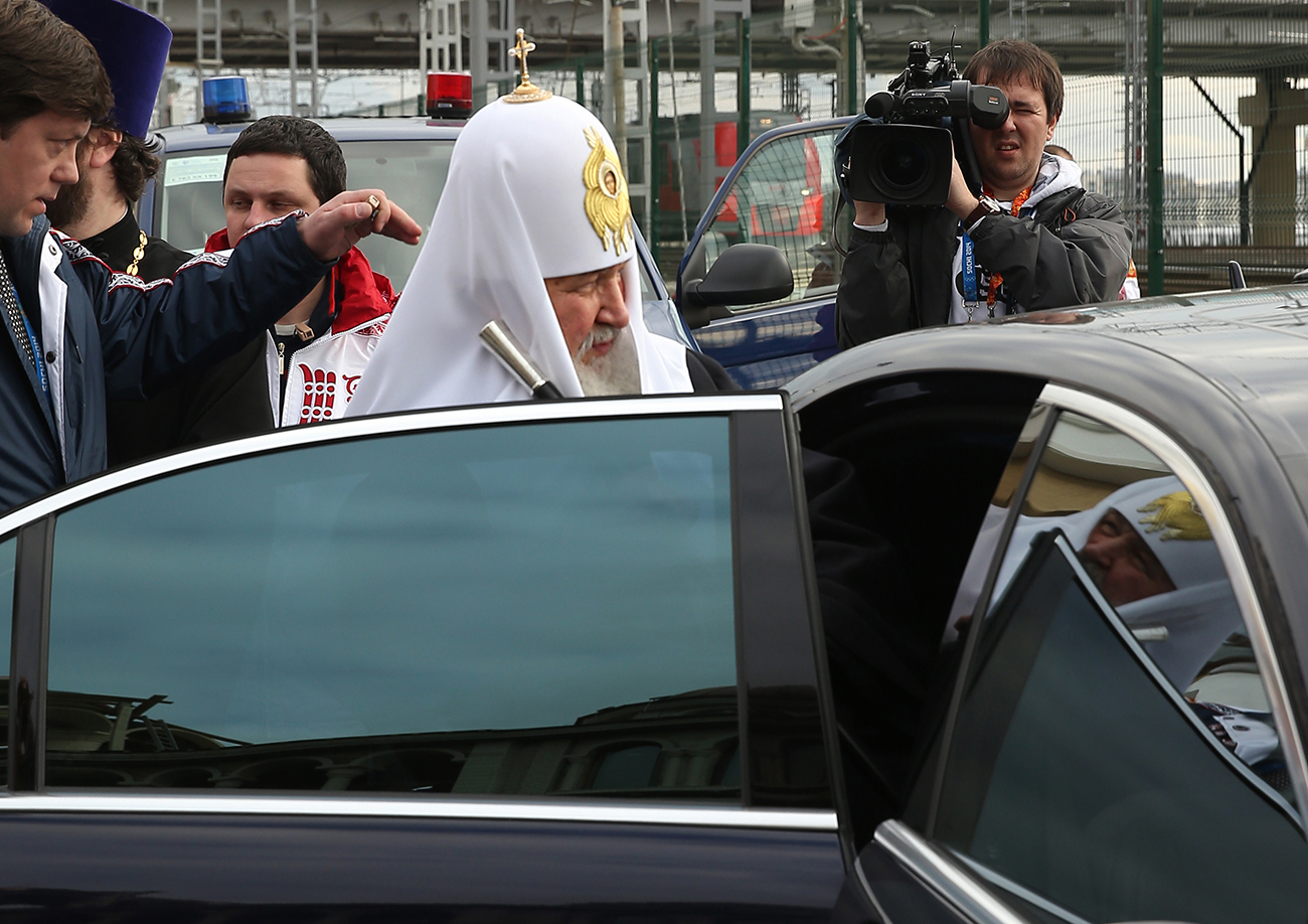 Patriarch Kirill of Moscow and all Russia steps into a car after a prayer service.