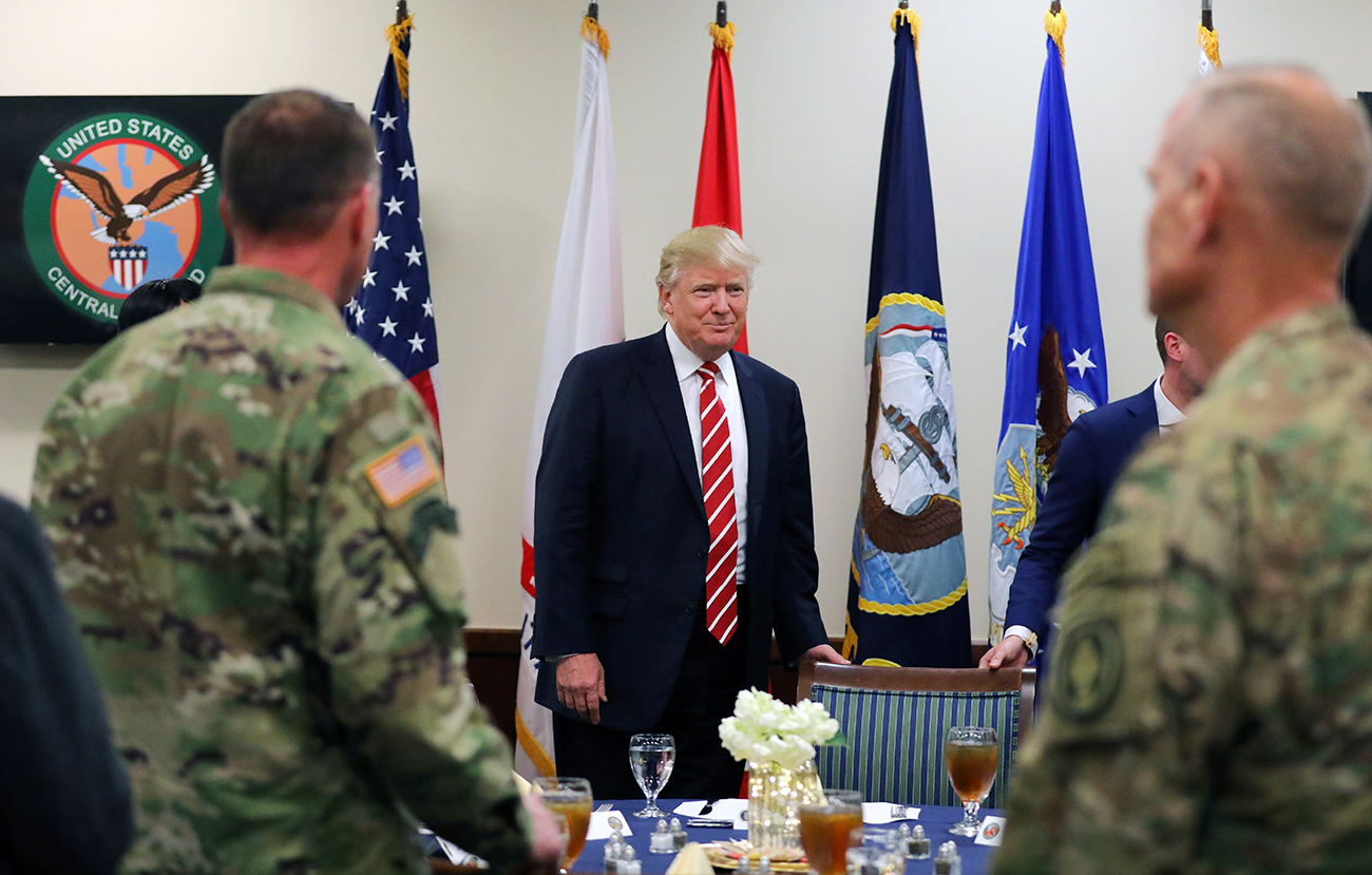 """Trump will see to it if to bring Crimea and Ukraine as part of the discussion, but he will not be fixated on that."" Photo: President Trump attends a lunch with members of the U.S. military."