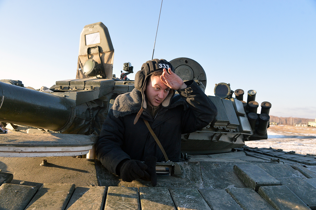 A tank driver in the T-80 tank
