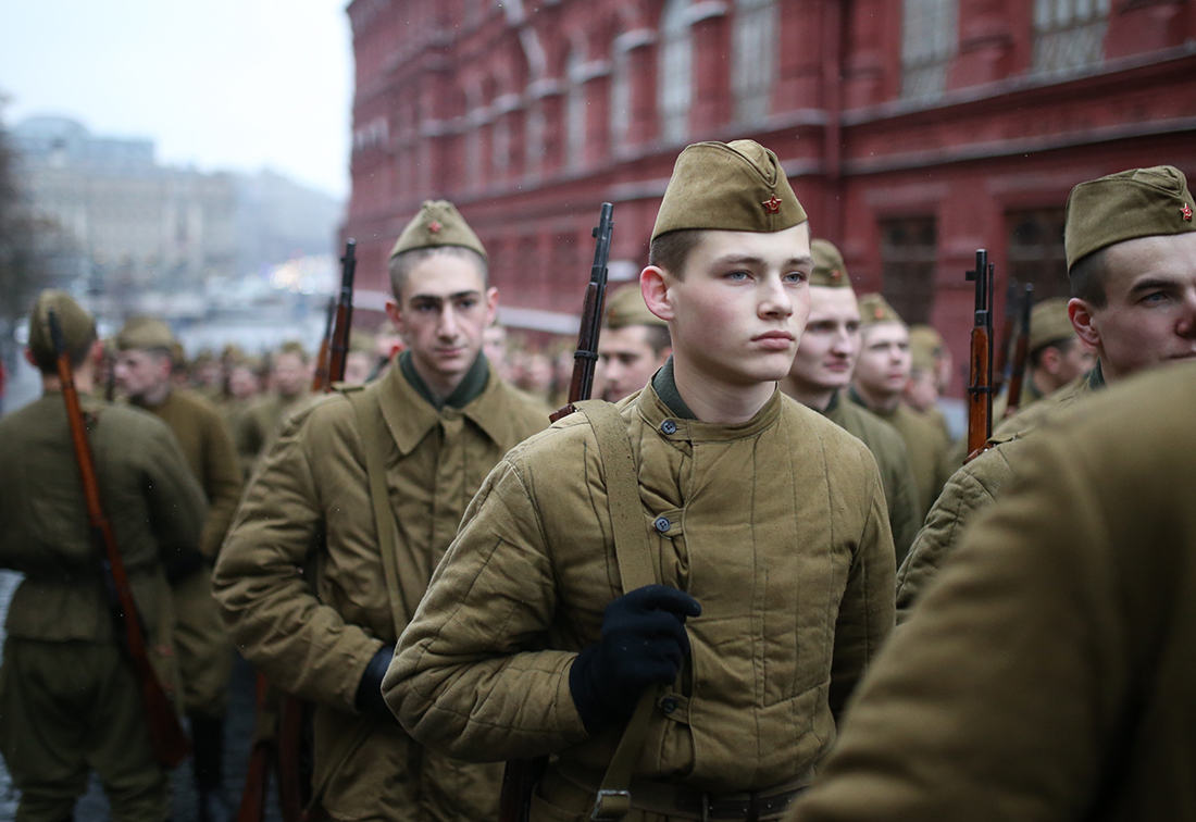 Participants dressed as Red Army soldiers march through Red Square during a military parade