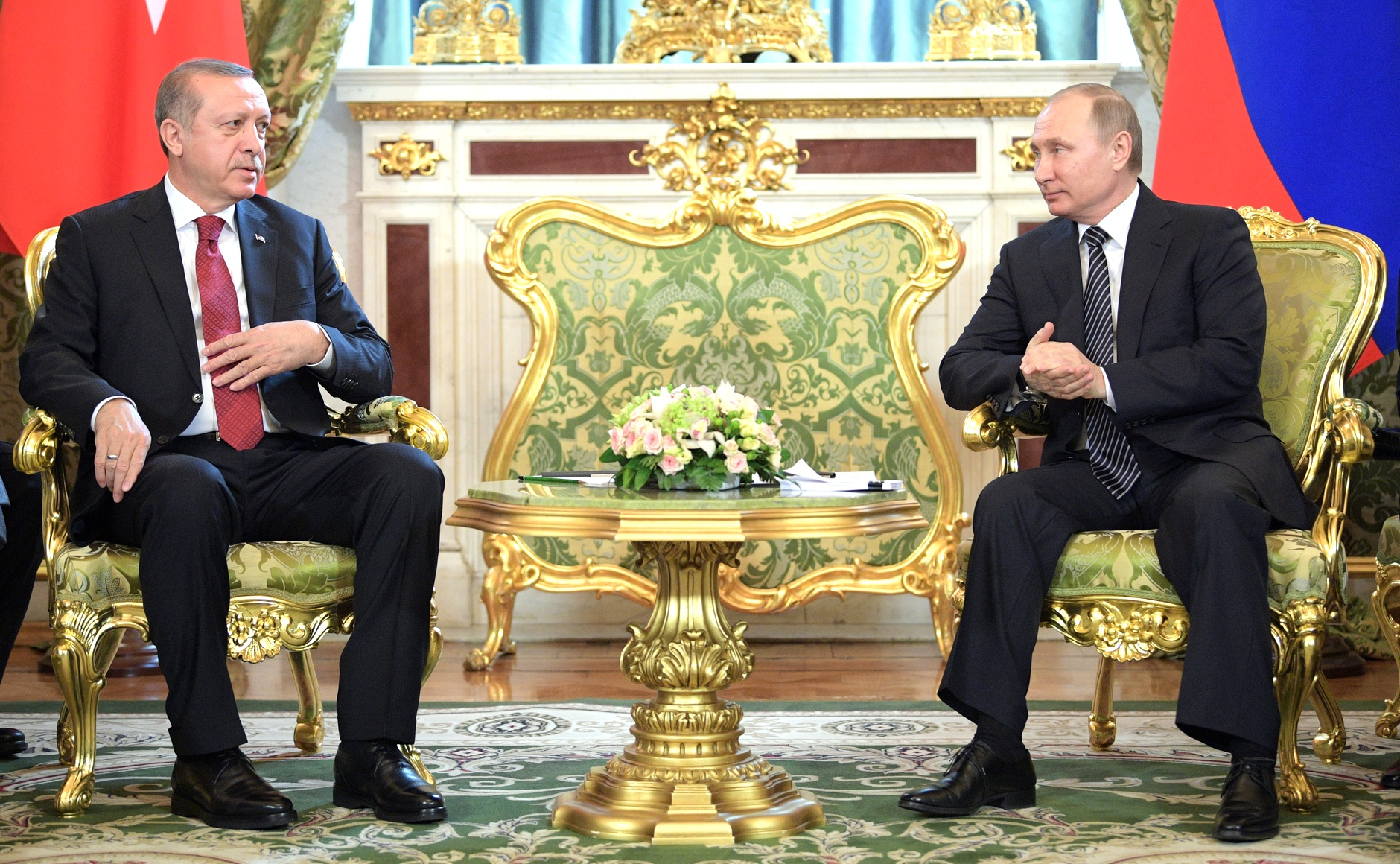 Vladimir Putin meets with Recep Tayyip Erdogan.