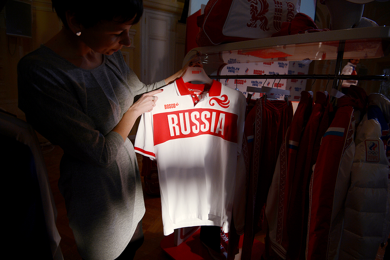 A girl examines a T-shirt, a part of the Russian Olympic team uniform, GUM, Moscow.