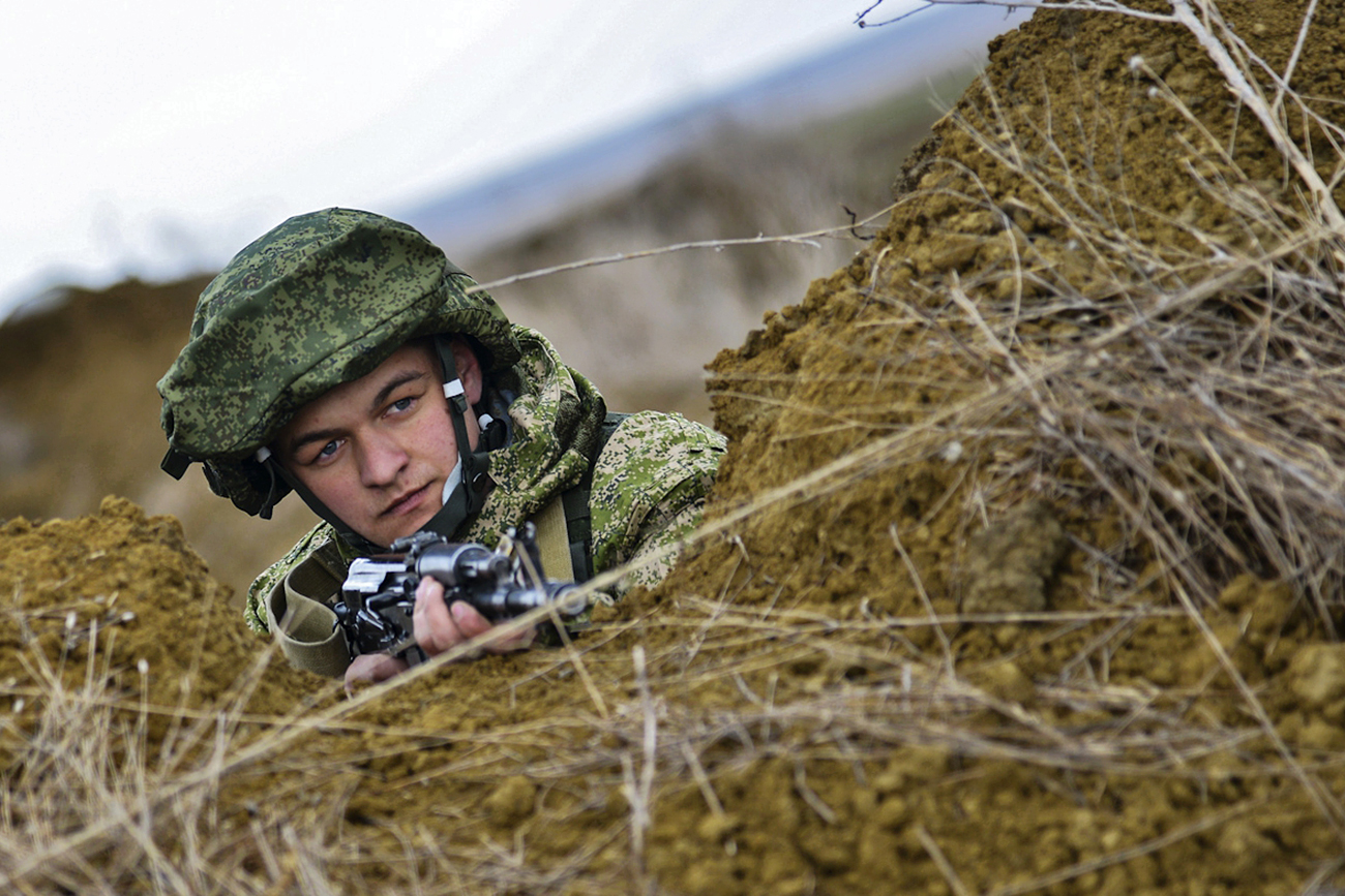 A serviceman of the Russian Armed Forces during a drill of the Airborne Forces at the Opuk training center in Crimea.