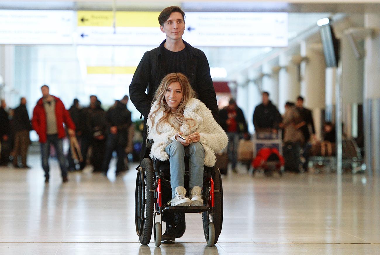 Singer Yulia Samoilova, Russia's Eurovision 2017 contestant, and her husband, Alexei Taran, at Sheremetyevo Airport.